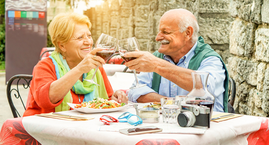 Couple Toasting with WIne in Italy
